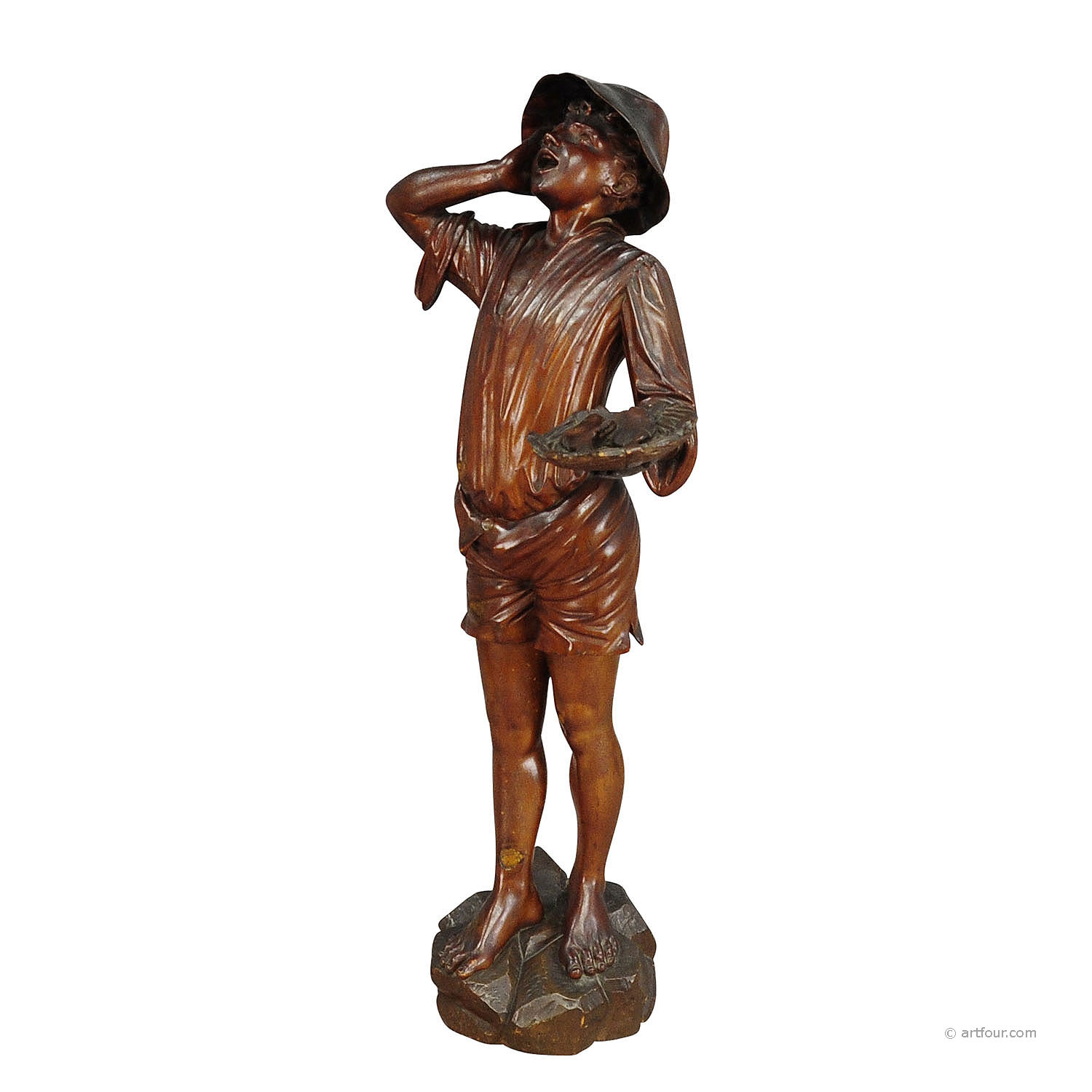 For sale an antique wooden carved statue of a fisher