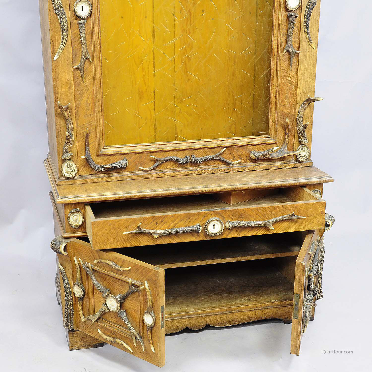 online for sale: an antique antler gun cabinet