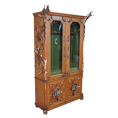 image of black forest antler gun cabinet ca. 1900