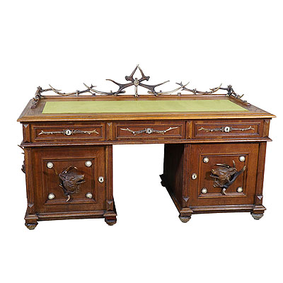 image of large oak wood desk with antler decorations by rudolf brix 1900