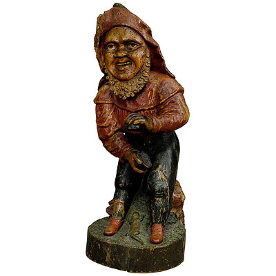 image of whimsical carving of a dwarf with snuffbox 19th century