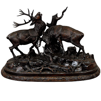image of grandiose carved wood fighting stags by rudolph heissl