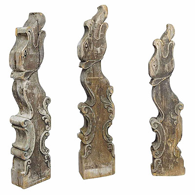 image of a set of three historical dragon head wood beams