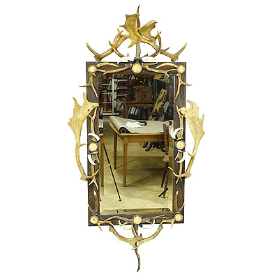 image of large antique mirror with rustic antler decorations