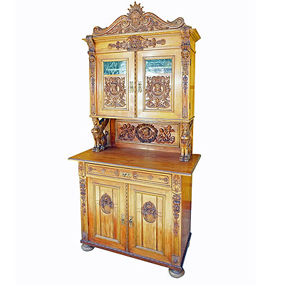 image of antique wooden carved cupboard with several carvings