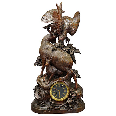 image of antique mantel clock with eagle and chamois family, ca. 1900
